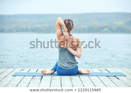 beautiful-young-woman-practices-yoga-450w-1229115685